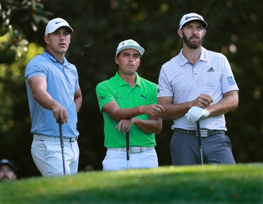 Rickie Fowler, center, and Dustin Johnson, right, will play in the Rocket Mortgage Classic at Detroit Golf Club.