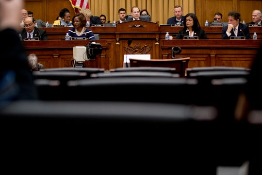 The witness chair reserved for Attorney General William Barr sits empty as Judiciary Committee Chairman Jerrold Nadler, D-N.Y., center background, gives his opening statement at a House Judiciary Committee hearing on Capitol Hill in Washington, Thursday, May 2, 2019.
