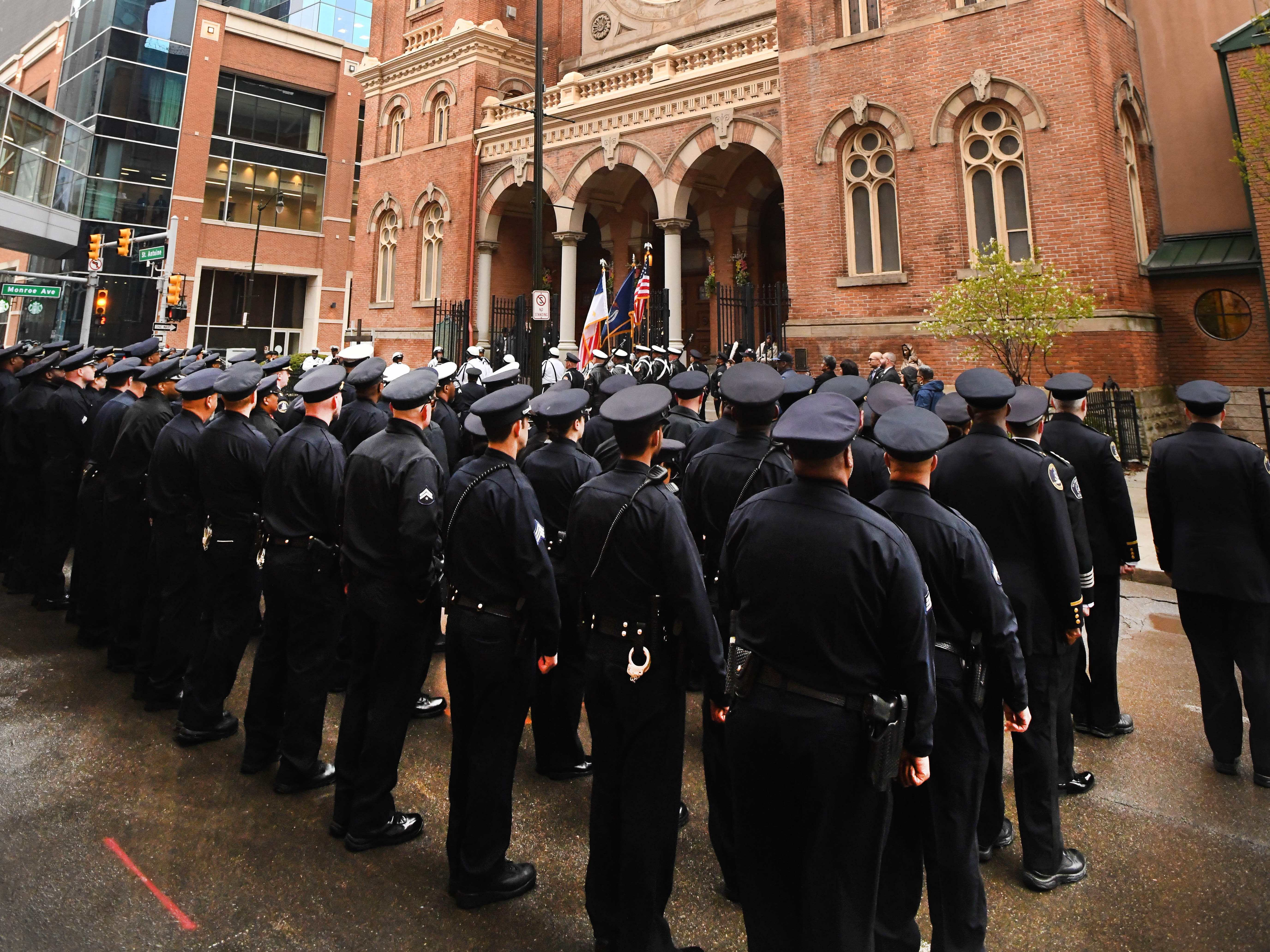 Detroit Police Officers stand at attention after marching to Old St. Mary's Church for the 46th Annual Detroit Police Interfaith Memorial Service.