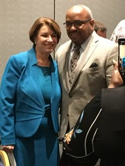 U.S. Sen. Amy Klobuchar, D-Minnesota, poses with an attendee at the National Organization of Black County Officials' conference in Detroit on Friday, May 3, 2019.