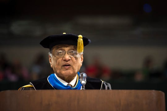 Acting Michigan State University president Satish Udpa speaks during commencement ceremonies Friday at the Breslin Center in East Lansing.