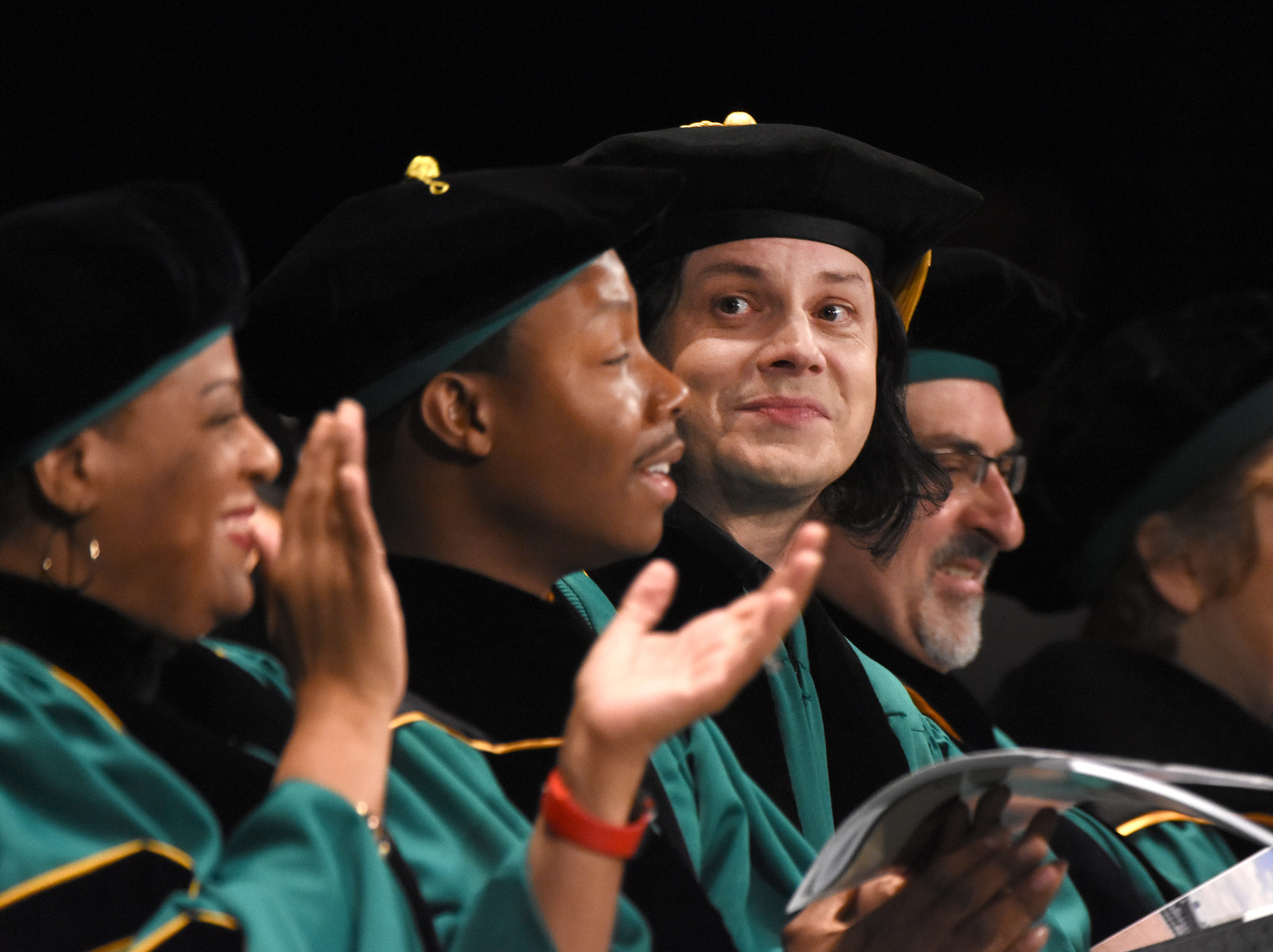 Musician Jack White reacts moments before receiving an honorary degree during the Wayne State University commencement exercises at the Fox Theatre on Friday, May 3, 2019.