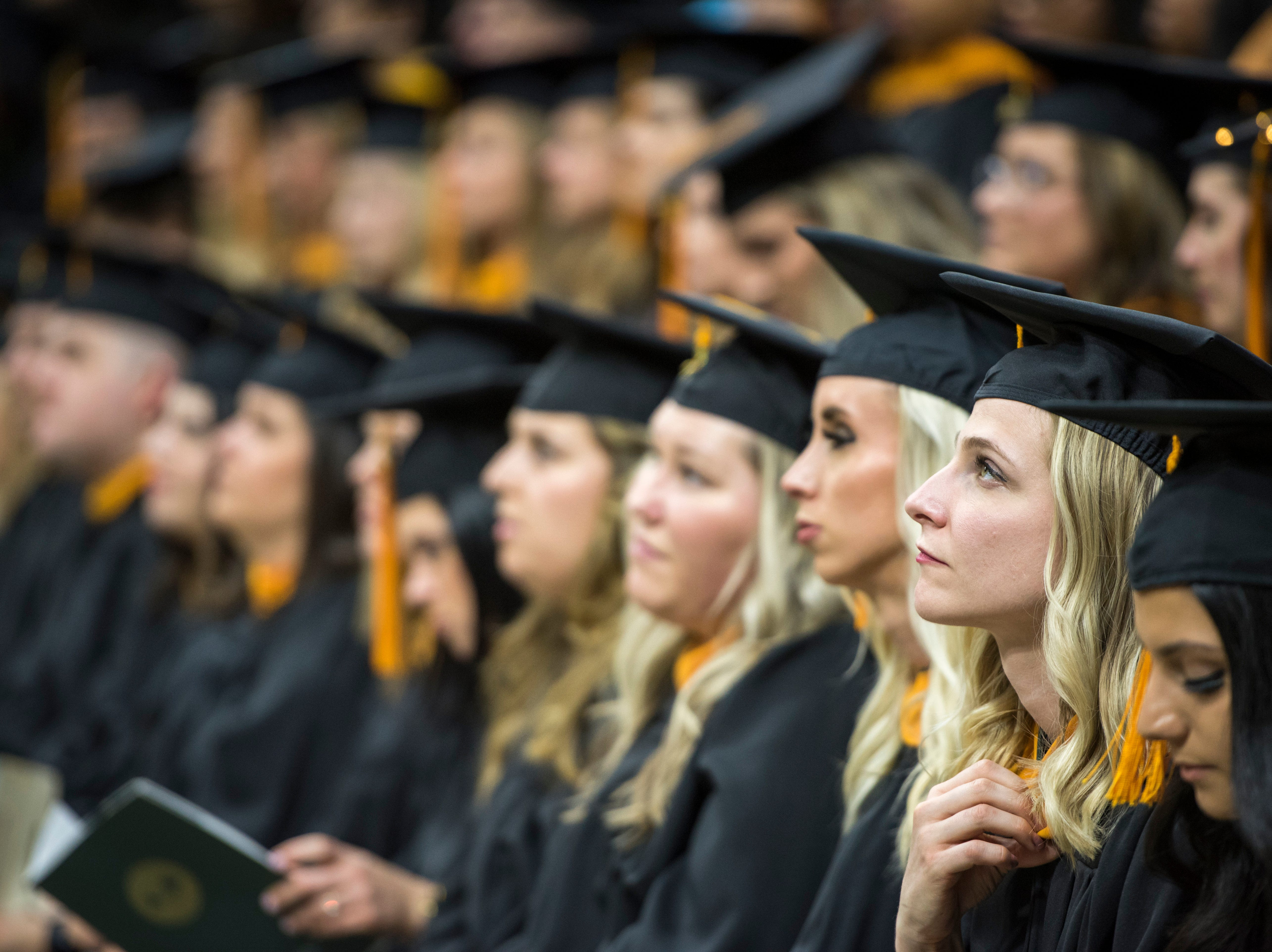 MSU graduates look on during the MSU Advanced Degrees Commencement ceremony at Breslin Center.