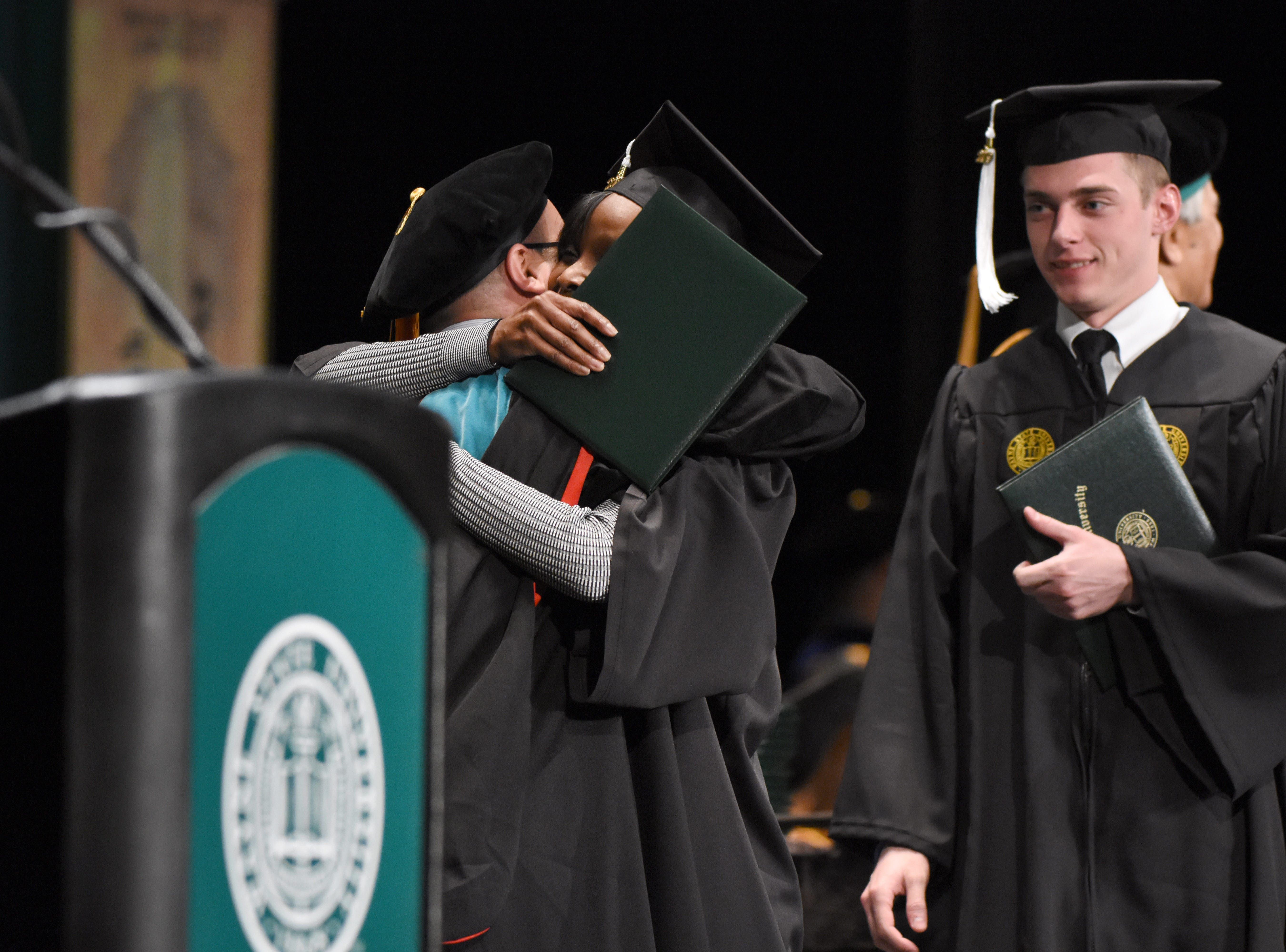 Wayne State University graduates celebrate as they receive their diplomas during commencement exercises at the Fox Theatre on Friday, May 3, 2019.