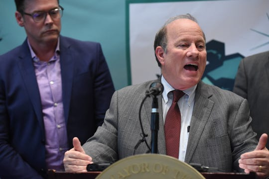Detroit Mayor Mike Duggan announces land deal agreements for a 5,000-job assembly plant in Detroit along with Mark Stewart (left), COO, FCA, with land acquisition agreements reached with Fiat Chrysler Automobiles' on Friday, May 3, 2019.