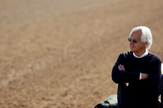 Trainer Bob Baffert watches a workout at Churchill Downs.