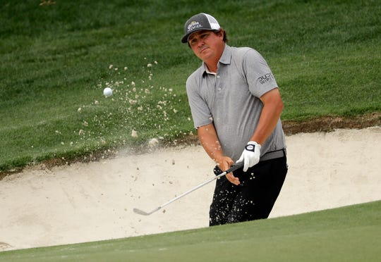 Jason Dufner hits from a sand trap on the 15th hole during the second round of the Wells Fargo Championship on Friday.