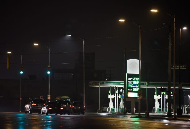 Bright street lights are surrounded by dimmed and discolored street lights on Gratiot Street at Gunston Street.