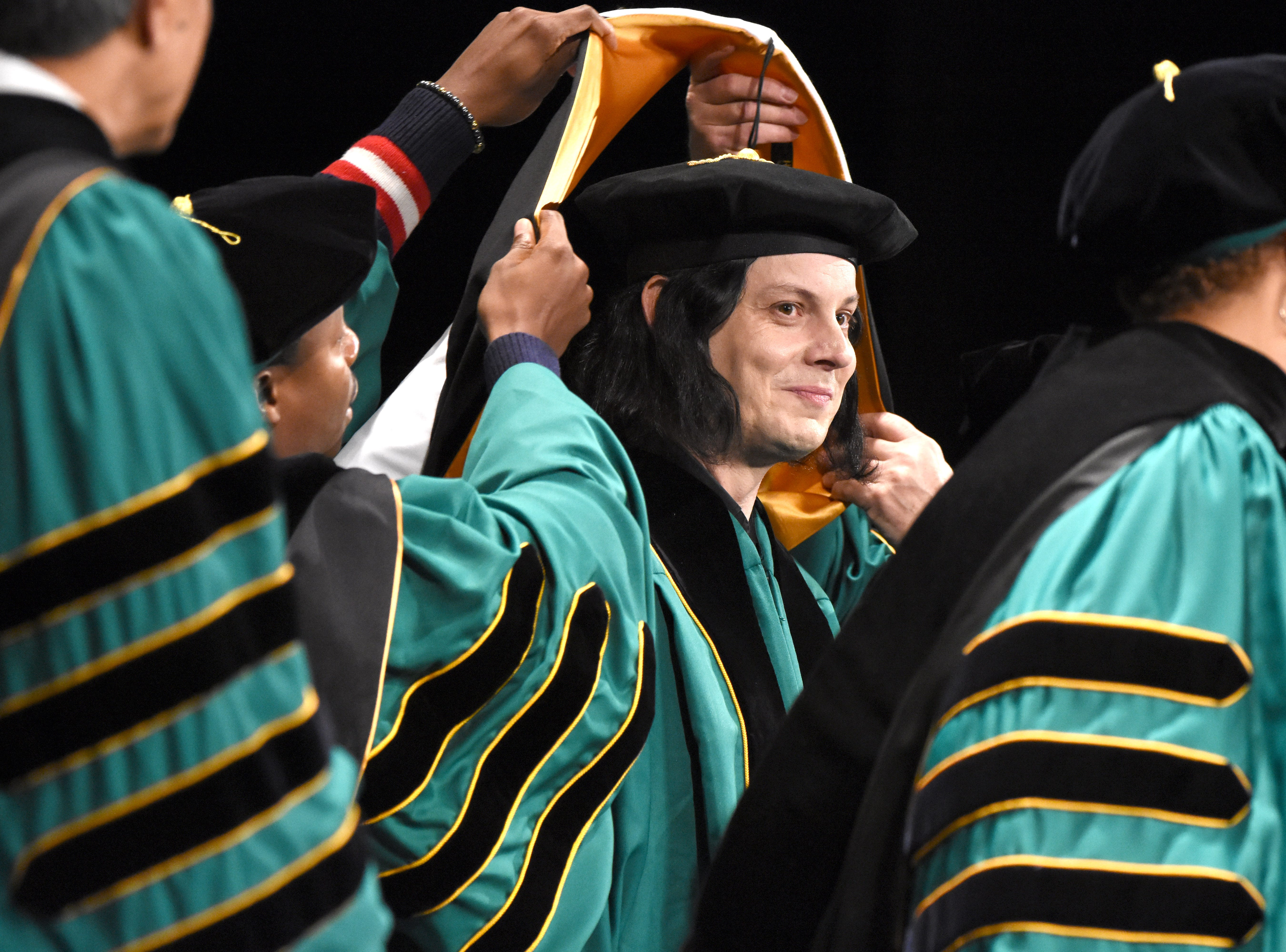 Musician Jack White receives an honorary degree during the Wayne State University commencement exercises at the Fox Theatre on Friday, May 3, 2019.
