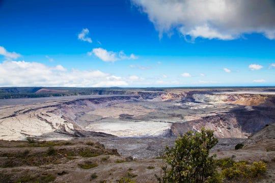 Halemaumau Crater and Kilauea Caldera at Kilauea volcano's summit inside Hawaii Volcanoes National Park in Hawaii.