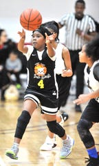 Top Ten Bad Girls starting point-guard Colleena Bryant (4) makes an outlet pass after stealing the ball from a Lady Legit player in the first half during a PAL youth basketball game.