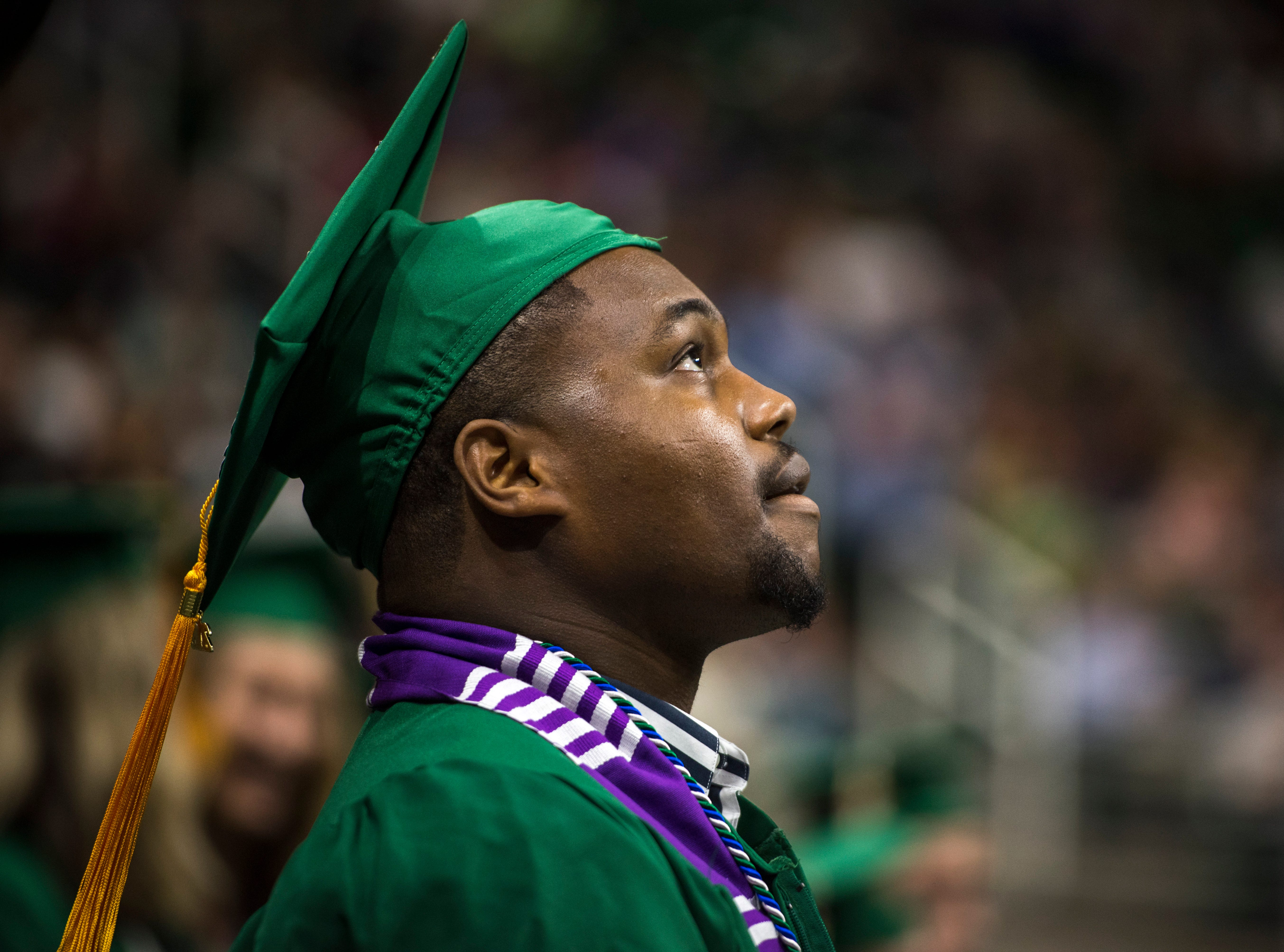 Nursing graduate Marlin Till looks on during the commencement exercises.