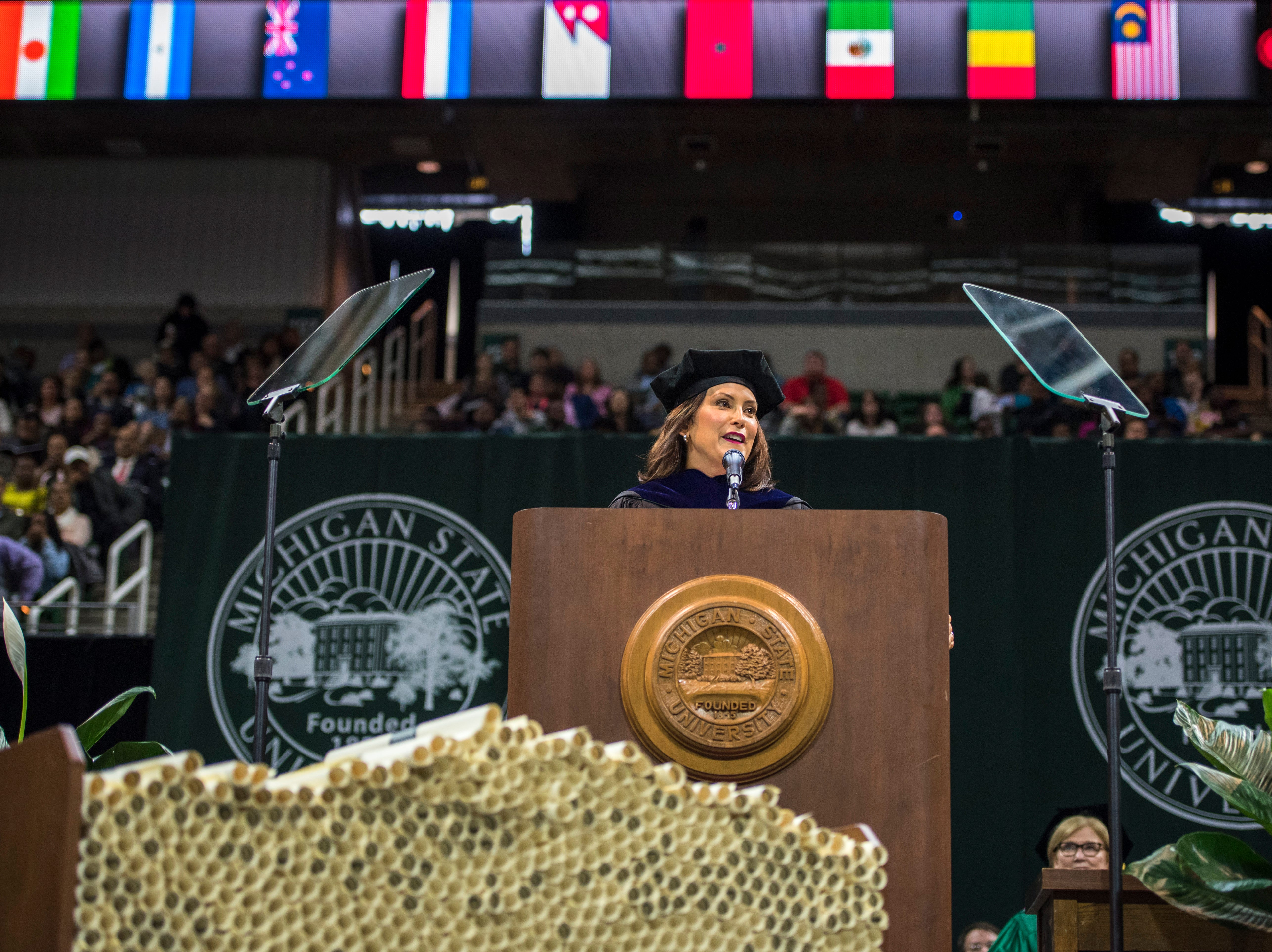 Gov. Gretchen Whitmer addresses the crowd of graduates and their families at Michigan State University.