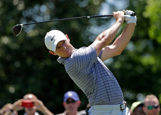 Rory McIlroy watches his tee shot on the third hole.