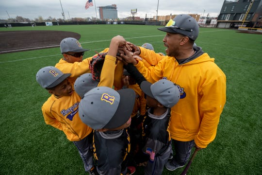 Dytarious Edwards, coach of the 11U Detroit Rangers, rallies his team before a Police Athletic League scrimmage against the YMCA Tigers at The Corner Ballpark, in Detroit April 30, 2019. For a story on the 50th anniversary of the Detroit PAL baseball program.