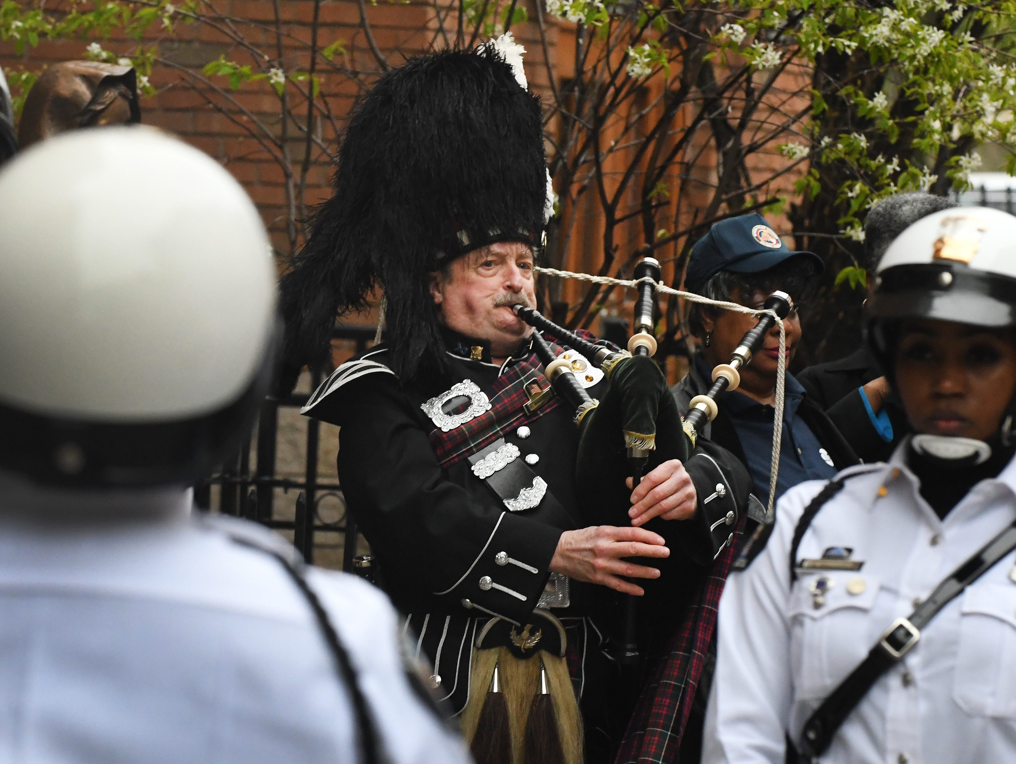 Bagpipes are played as Detroit Police officers make their way to the 46th Annual Detroit Police Interfaith Memorial Service.  Detroit Police Department march and 46th Annual Detroit Police Interfaith Memorial Service to honor fallen officers at Old St. Mary's church in Detroit, Michigan on May 3, 2019. (Image by Daniel Mears/ The Detroit News).