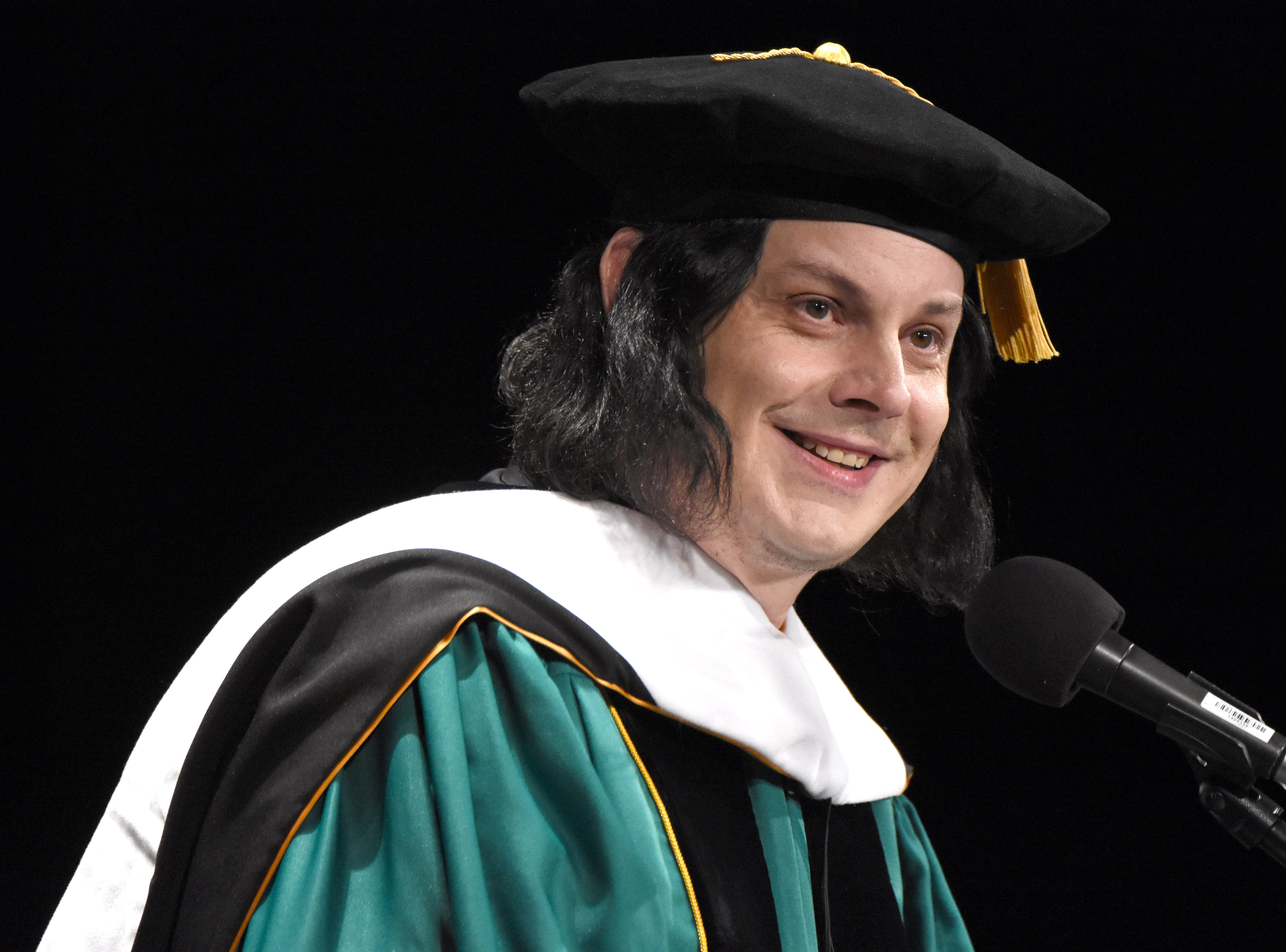 Musician Jack White speaks to graduates after receiving an honorary degree during the Wayne State University commencement exercises at the Fox Theatre on Friday, May 3, 2019