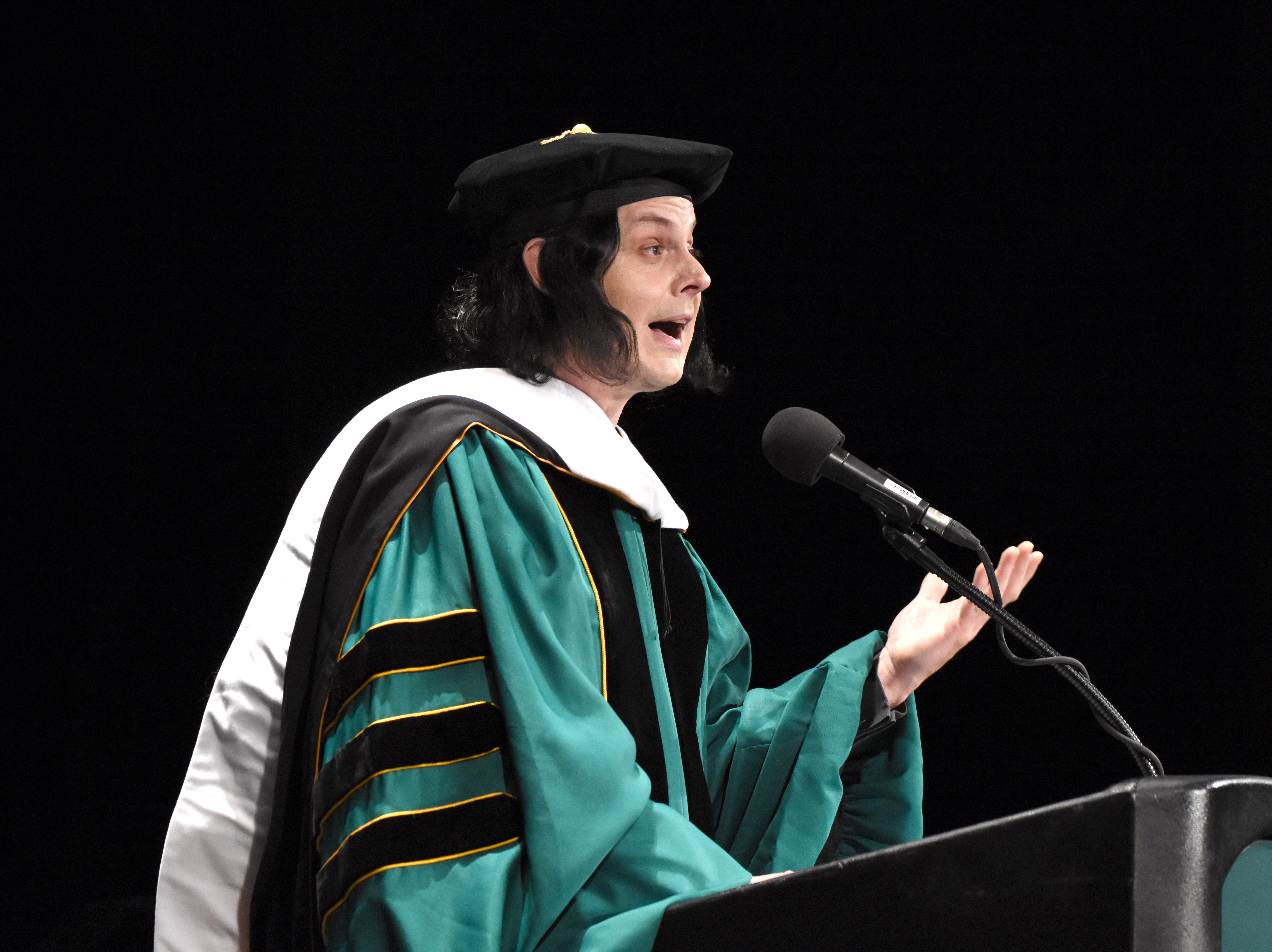 Musician Jack White addresses graduates after receiving an honorary degree during the Wayne State University commencement exercises at the Fox Theatre on Friday, May 3, 2019.