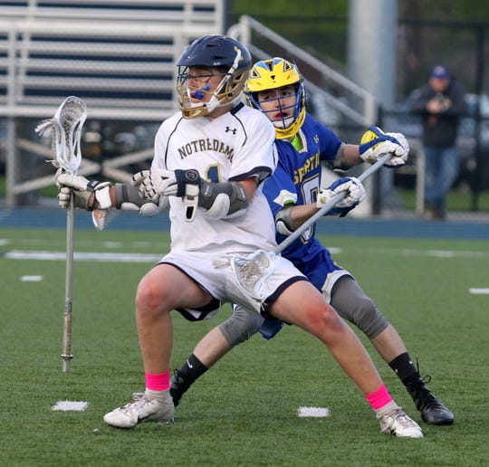 Owen Spring of Elmira Notre Dame is defended by Maine-Endwell's Cameron Bobier on May 2, 2019 at Notre Dame.