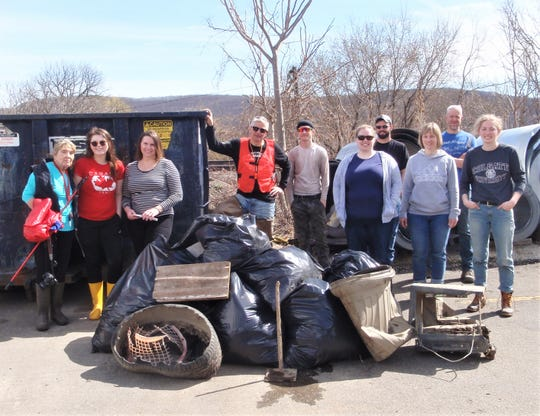 Chemung River Friends Executive Jim Pfiffer, with orange vest, and volunteers show off 400 pounds of trash and litter cleaned up from Elmira's Heller Creek.