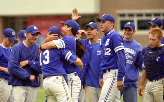 Horseheads head coach Jeff Limoncelli hugs Rob Phillips after the Blue Raiders claimed the Section 4 Class A championship June 3, 1999 with a 6-2 win over Binghamton at Cornell University's Hoy Field on June .