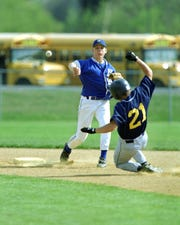 Horseheads' Charlie Hasty turns a double play during a victory against Elmira Notre Dame in the 1999 season.