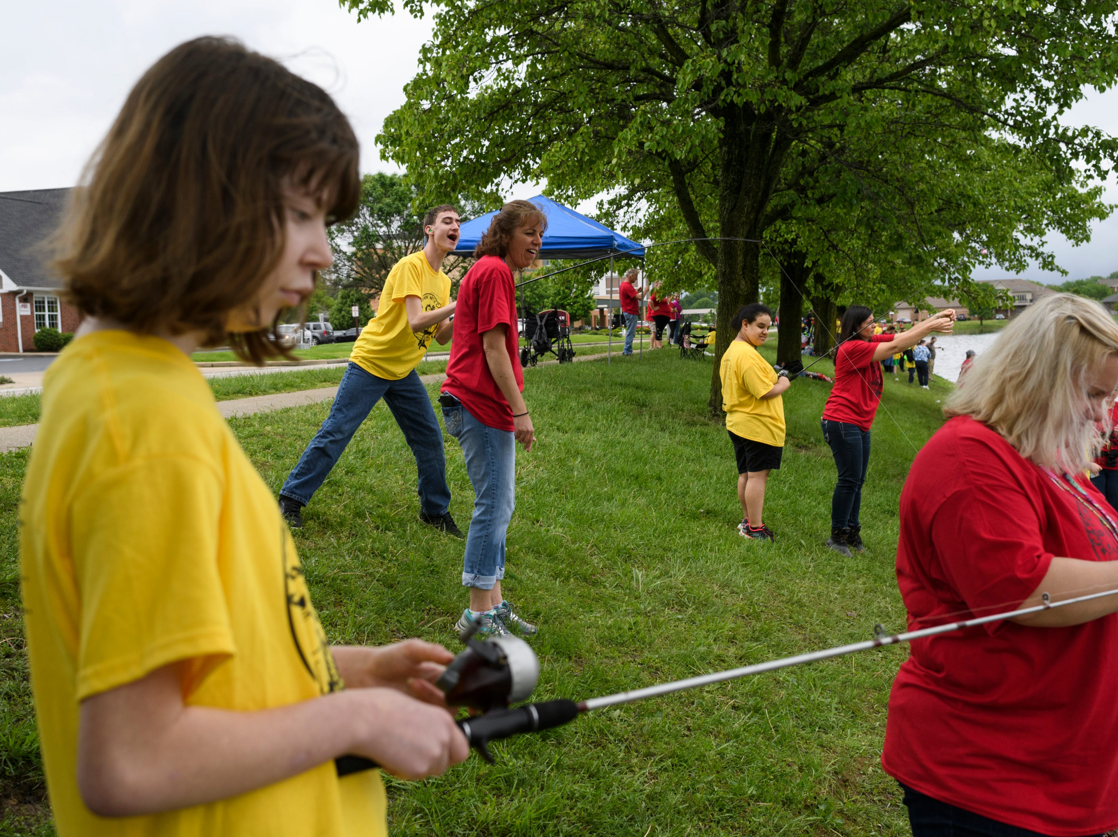 """Students from North Junior High School participate in the 12th annual """"Catchin' with Capin"""" event at Eagle Lake in Evansville, Ind., Friday, May 3, 2019."""