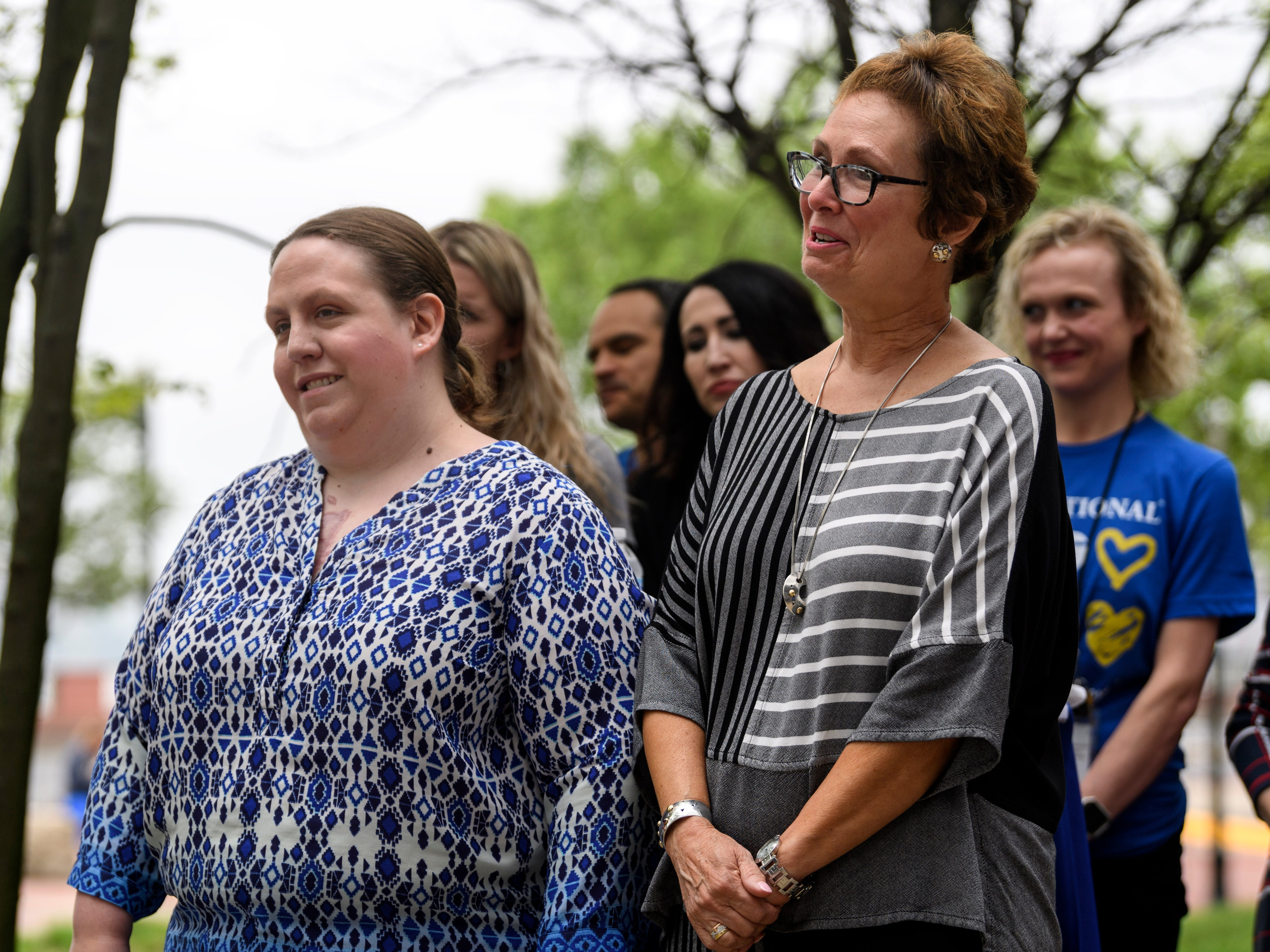 Bob Jones's daughter Carolyn, left, and wife Lisa, right, listen as he thanks the large crowd in attendance at his retirement party held outside of Old National Bank in downtown Evansville, Ind., Friday, May 3, 2019.