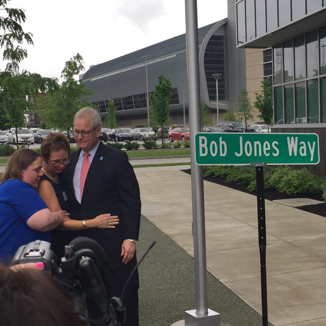 Bob Jones, with wife Lisa and daughter Carolyn, reacts to Friday's announcement that a section of Walnut Street in Downtown Evansville is being renamed in his honor.