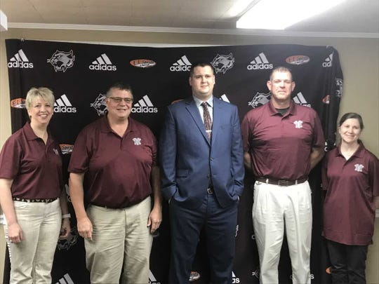 Joe Newcomb poses with members of the Mount Vernon school board. The Eastern (Pekin) grad was named the next boys basketball coach of the Wildcats.