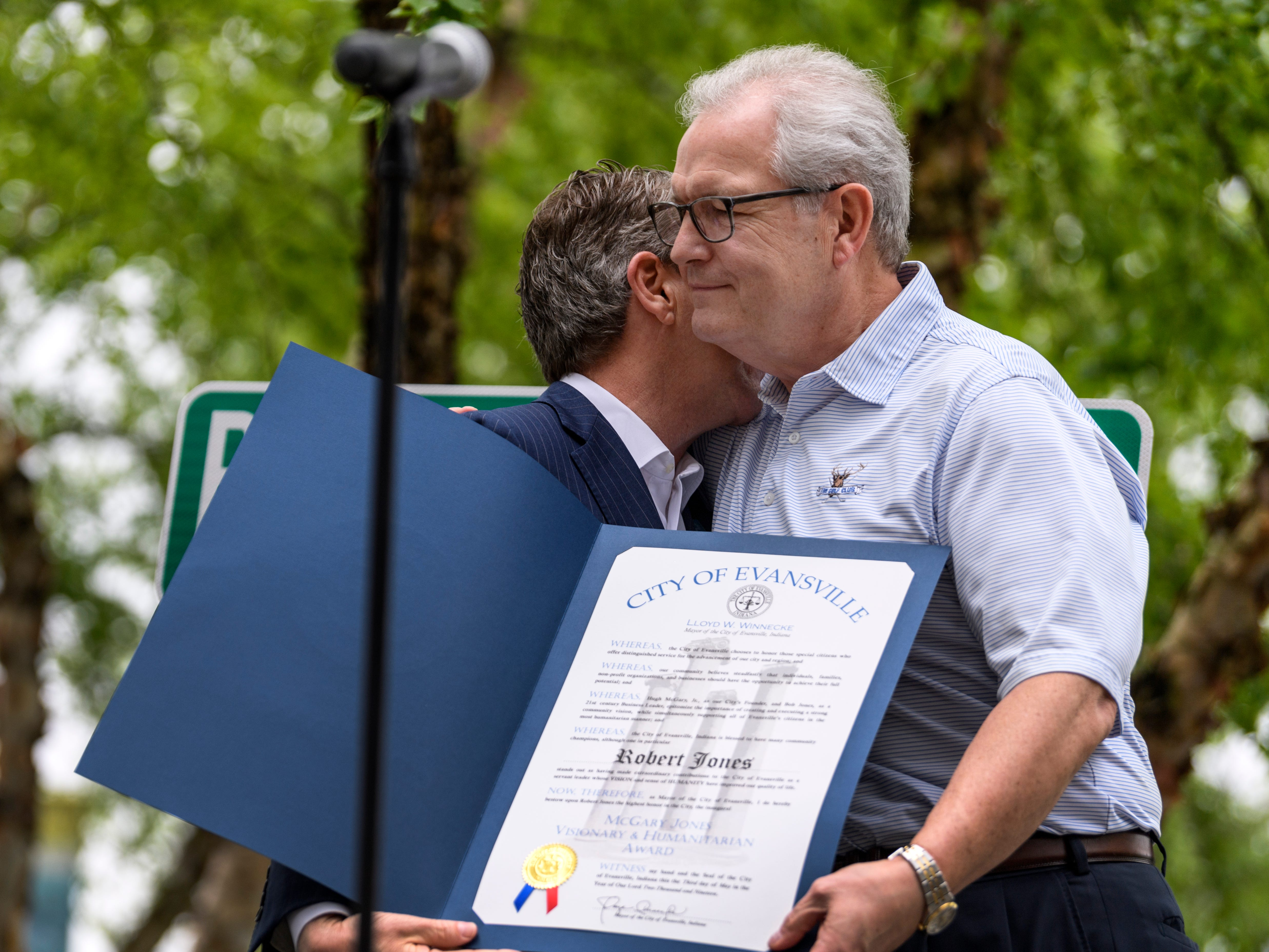 Mayor Lloyd Winnecke, left, embraces Bob Jones, right, Old National's retiring chief executive officer, during a farewell party held outside of Old National Bank in downtown Evansville, Ind., Friday, May 3, 2019. Mayor Winnecke proclaimed CEO Jones as the first recipient and namesake of the inaugural McGary Jones Visionary & Humanitarian Award.