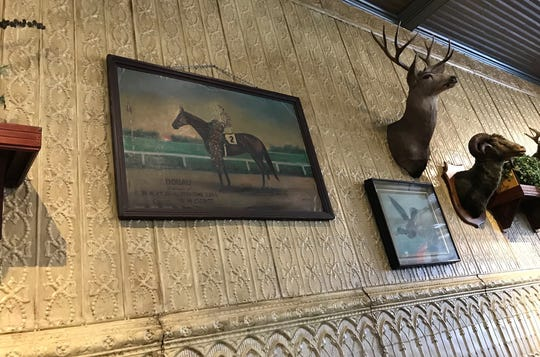 A photo of Donau, winner of the 1910 Kentucky Derby, hangs in the Gerst Haus in Evansville, Indiana.