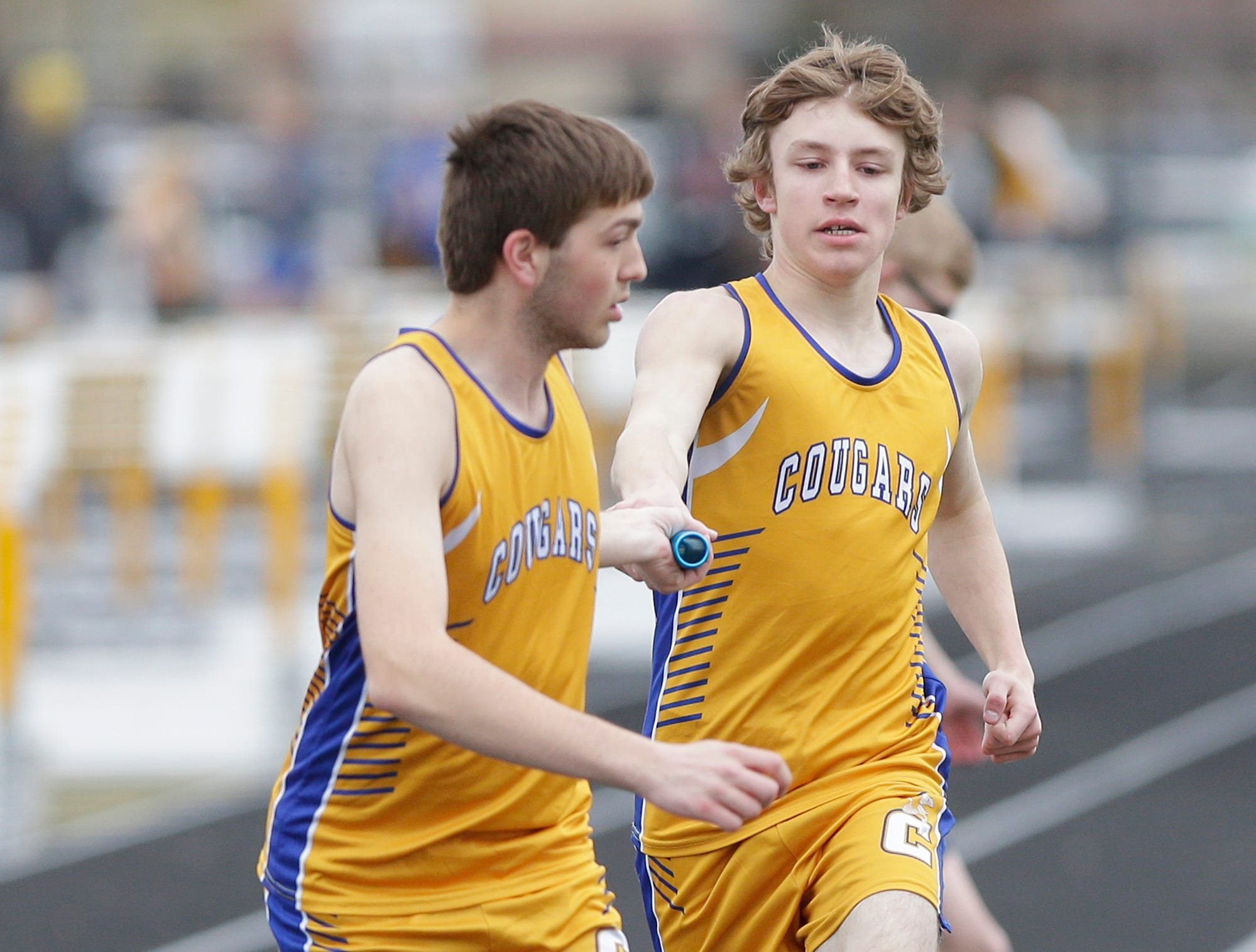 Connor Hamm of Campbellsport High School grabs the baton from Jerid Waddle in the 4x800 meter relay Friday, May 3, 2019 at the Waupun High School Invitational track and field meet. Doug Raflik/USA TODAY NETWORK-Wisconsin