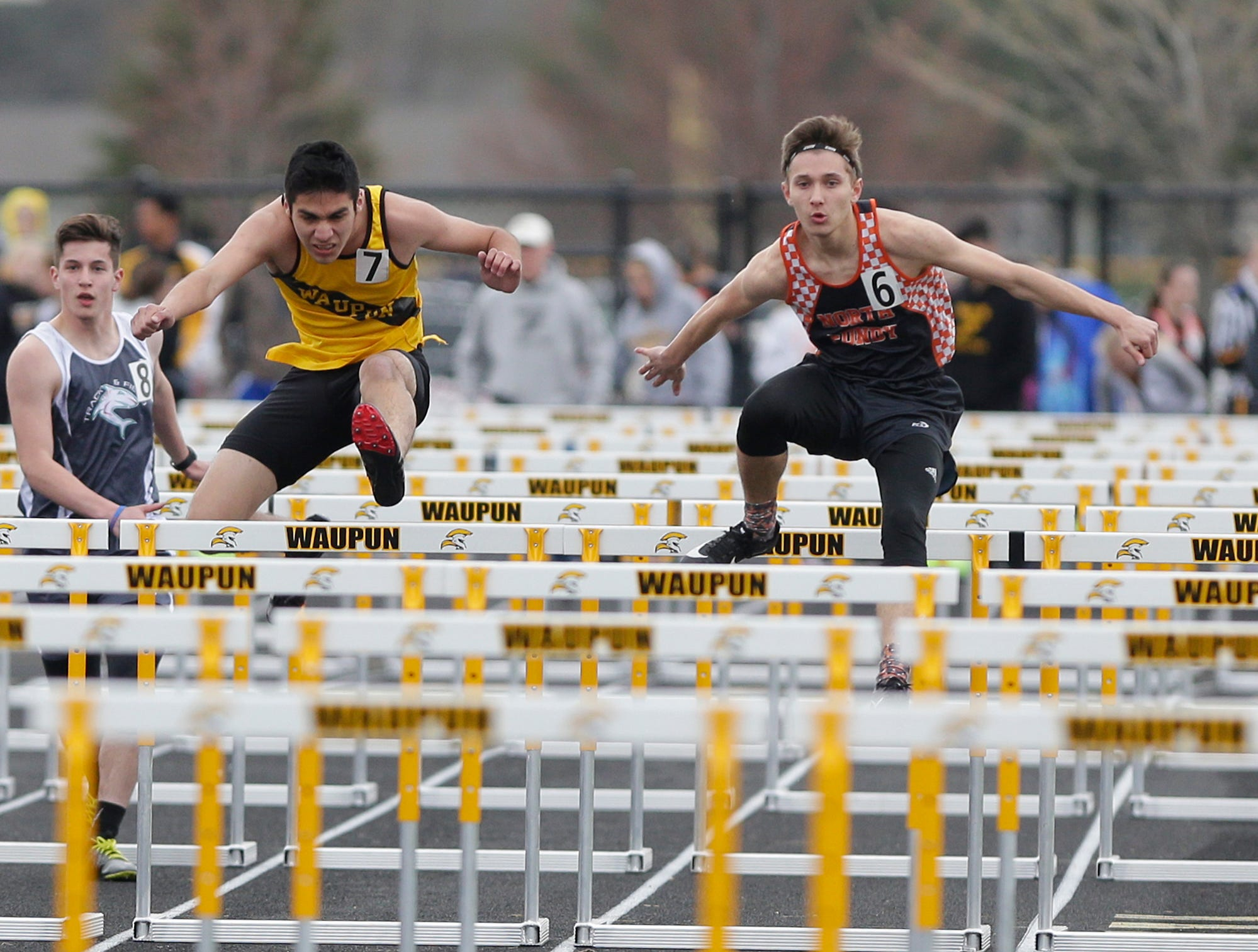 Jeremy Jimenez of Waupun High School (7) and Cameron Hilt of North Fond du Lac High School compete in the 110 meter hurdles Friday, May 3, 2019 at the Waupun High School Invitational track and field meet. Doug Raflik/USA TODAY NETWORK-Wisconsin