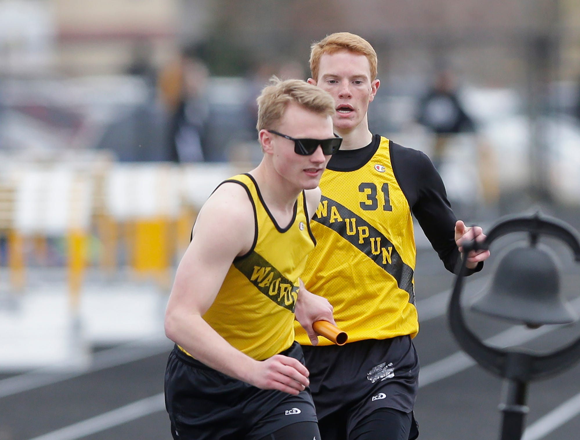 Kanon Smit of Waupun High School grabs the baton from Rhyer Smit in the 4x800 meter relay Friday, May 3, 2019 at the Waupun High School Invitational track and field meet. Doug Raflik/USA TODAY NETWORK-Wisconsin