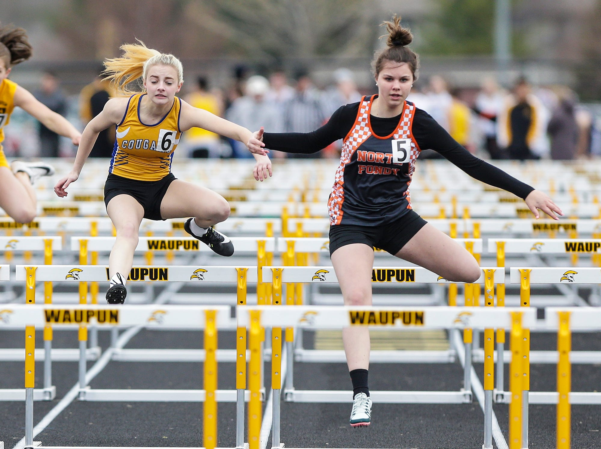 Laurelyn Pritzlaff of Campbellsport High School (6) and Josey Wallender of North Fond du Lac High School compete in the 100 meter hurdles Friday, May 3, 2019 at the Waupun High School Invitational track and field meet. Doug Raflik/USA TODAY NETWORK-Wisconsin