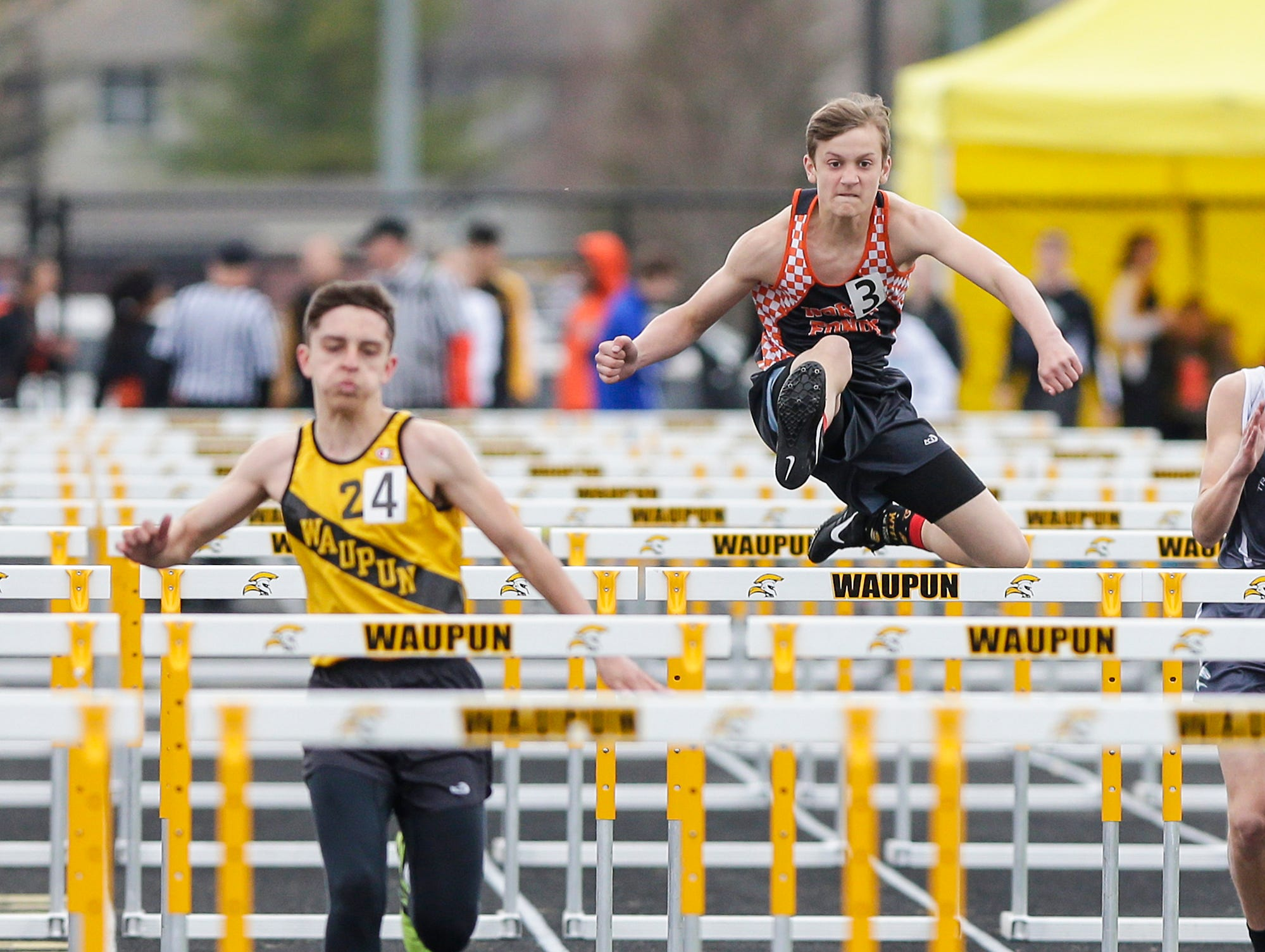 Jacob Matoushek of Waupun High School (4) and Kayden Biwer of North Fond du Lac High School compete in the 110 meter hurdles Friday, May 3, 2019 at the Waupun High School Invitational track and field meet. Doug Raflik/USA TODAY NETWORK-Wisconsin