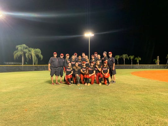 The North Fort Myers softball team celebrates with their district championship trophy following their 6-4 victory against Mariner on the road.