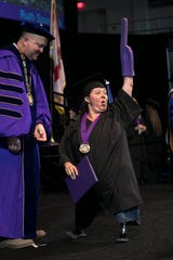 Ruth Spurlock cheers while walking across the stage at her graduation from Florida Southwestern State College on Friday, May 3, 2019, in Fort Myers.