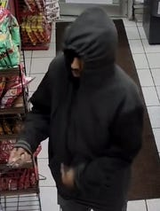 Green Bay Police are looking for a man in connection with an armed robbery at a Marathon gas station in Green Bay Thursday night.