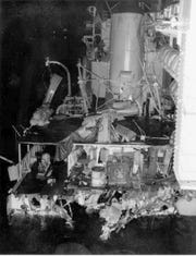 The aft section of the  USS Frank E. Evans after the ship was cut in half it a collision with the HMAS Melbourne, an Australian aircraft carrier, during a training exercise in 1969.