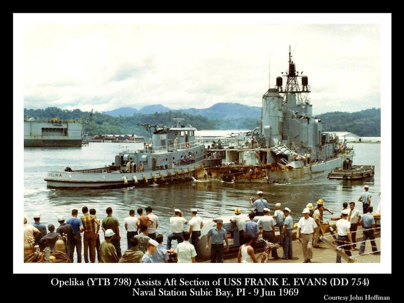 A tug brings the aft section of the USS Frank E. Evans into Subic Bay in the Philippines.