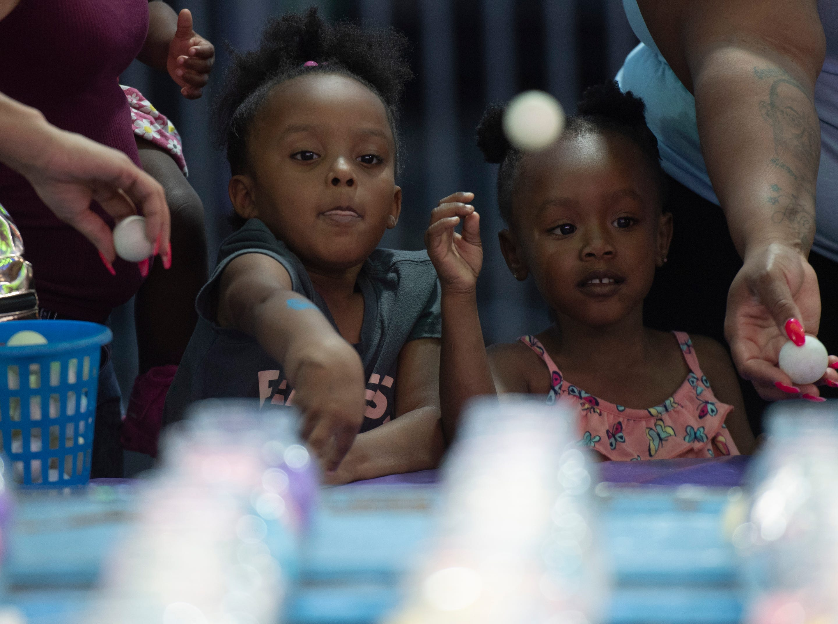 Lea Rice (left), 5, and Nevaeh Hunter, 4, try to win fish on opening day of The Great Anderson County Fair Thursday, May 2, 2019.