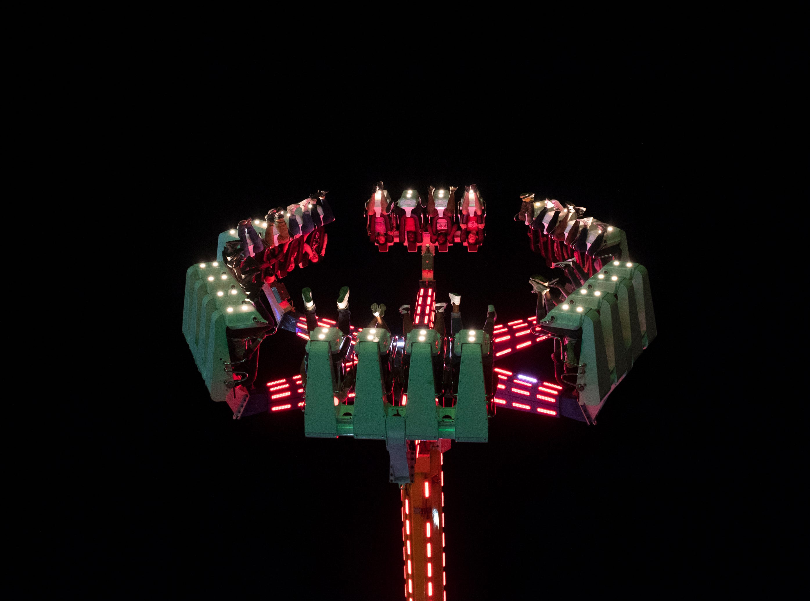 """Fair goers ride """"Cyclops"""" on opening day of the Great Anderson County Fair Thursday, May 2, 2019."""