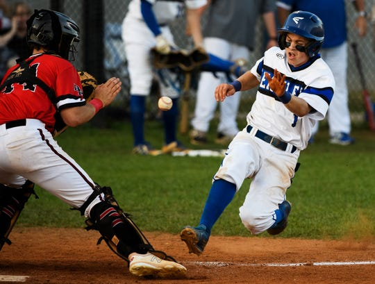 Eastside's David Mershon (1) begins to slide into home plate as Blue Ridge's TJ Highsmith (14) attempts to catch the ball during their playoffs game Thursday, May 2, 2019.