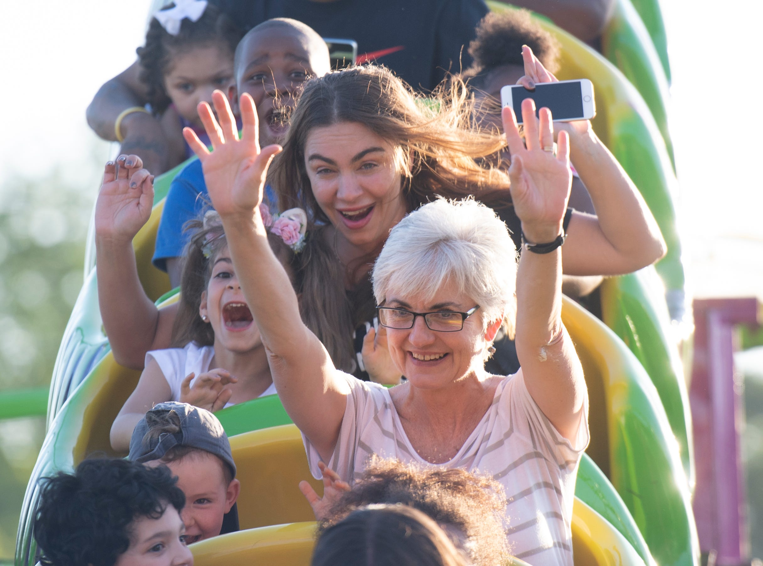 Maria Gil and her daughter Angelina, 6, ride behind Carol Vinzant and her grandson Arol Vedenhaupt, 4, on opening day of The Great Anderson County Fair Thursday, May 2, 2019.