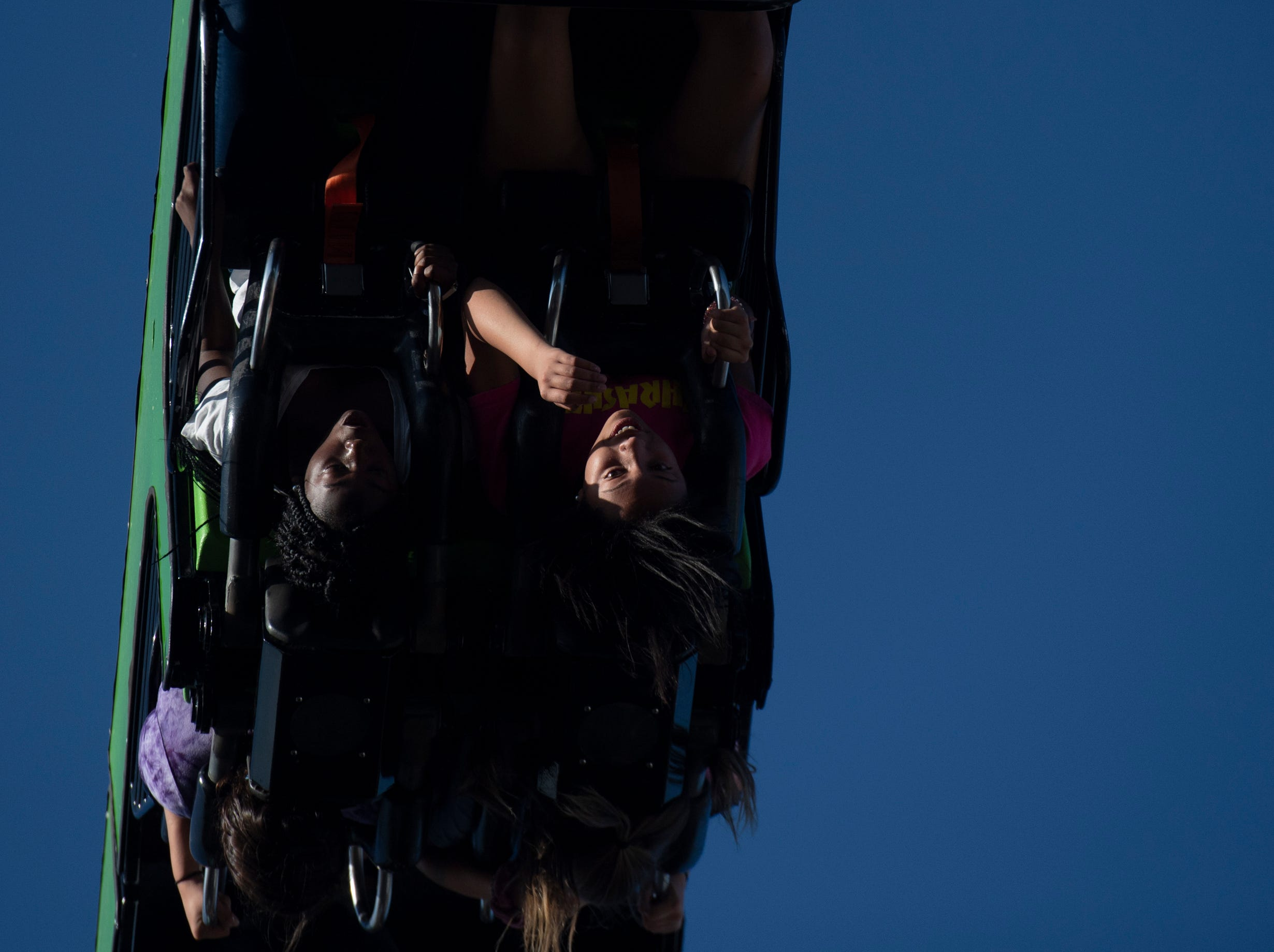 Brantiya Ellis (right), 14, and Zy'Kia Brown, 14, of Anderson ride the Mantis on opening day of The Great Anderson County Fair Thursday, May 2, 2019.