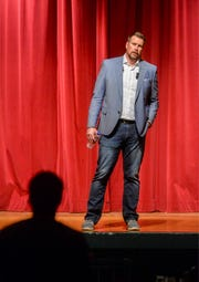 Ryan Leaf takes a question from the audience after his talk at the CMR Auditorium, Thursday evening.