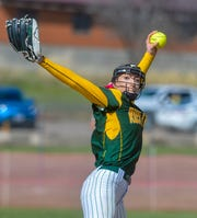 CMR's Madison Moore delivers to the plate during the crosstown softball game on Thursday.