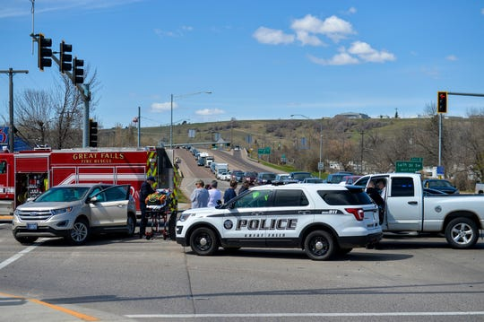 Traffic backs up on the I-15 off-ramp at the Marketplace Exit as first responders attend to people involved in a crash at the intersection of Fox Farm Road and 10th Avenue South on Friday.